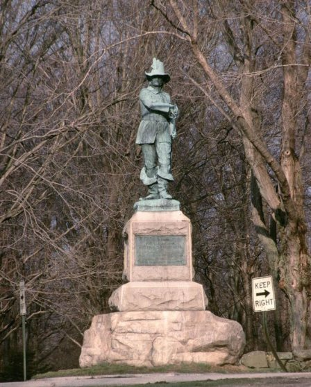 The statue at its original location in Mystic, where it was installed in 1889. The statue was originally placed at the intersection of Pequot Avenue and Clift Street in Mystic, Connecticut (actually within the town of Groton), near what was thought to be one of the original Pequot forts.