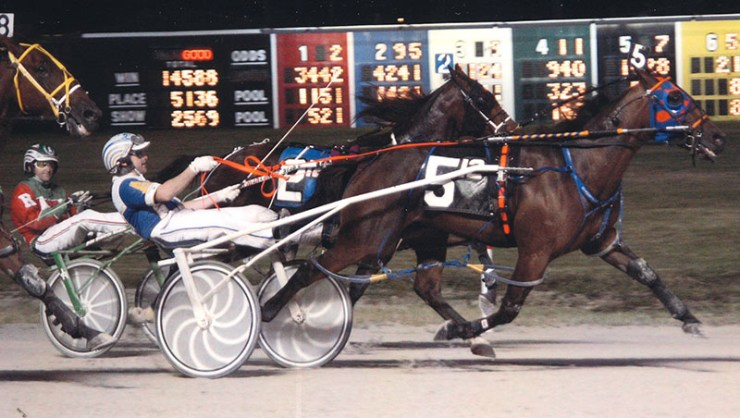 Kaydon Begone winning a race at Maywood Park on August 30, 2013