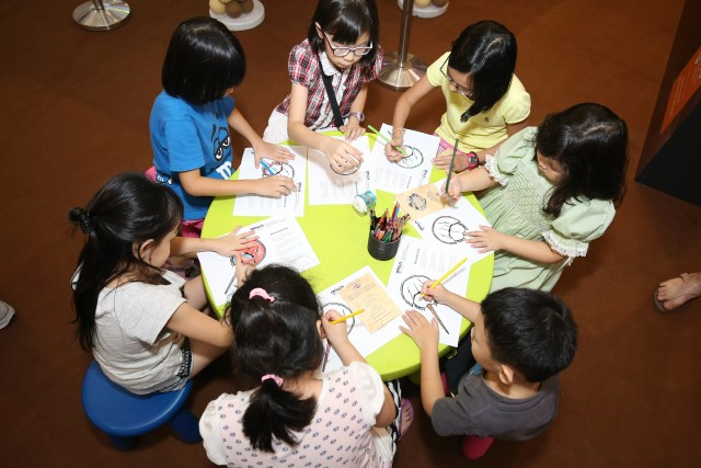 Children enjoying the coloring session at the Lee Kong Chian Natural History Museum
