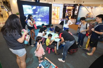 Parents and children trying out the craft at the Resorts World Sentosa showcase
