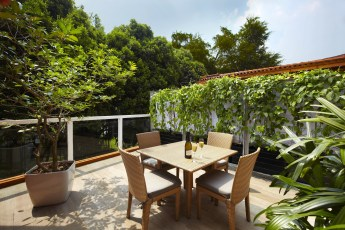 Naumi Liora Outdoor Porch with Lush Greenery
