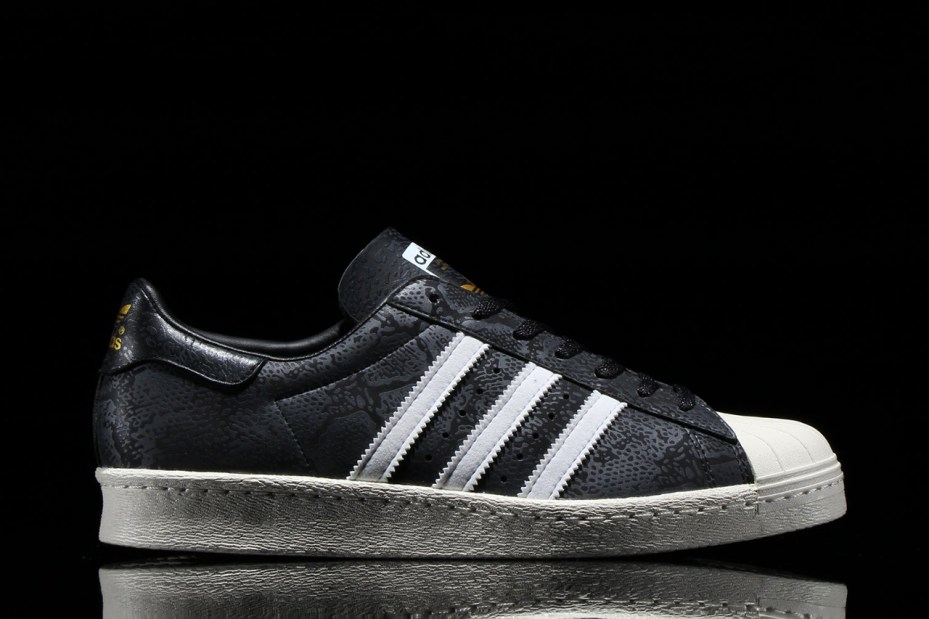 lowest price 357f1 83ca4 The latest exclusive release sees the brand s classic Superstar 80s  silhouette in black, with reflective 3M detailing and ...