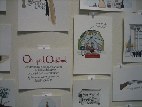 "Susie Cagle, ""Occupied Oakland, An Illustrated History,"" 2011-2012, watercolor on paper, dimensions vary. (photo by author)"