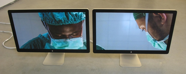 """Massimo Grimaldi, """"Emergency's Surgical Center in Goderich, Photos Shown on Two Apple Thunderbolt Displays"""" (2013). Two Apple Thunderbolt displays, two Apple Mac Minis, double slideshow, dimensions variable, unique. Shown on Two Apple Thunderbolt Displays"""" (2013). Two Apple Thunderbolt displays, two Apple Mac Minis, double slideshow, dimensions variable, unique."""