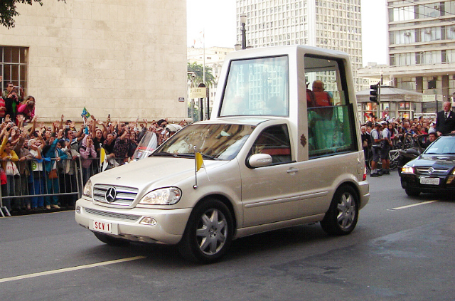 Pope Benedict XVI in the Popemobile (via)