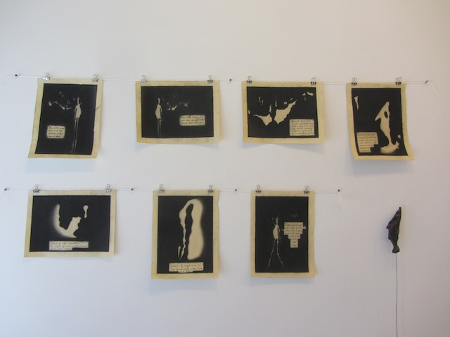 "Paul D'Agostino, ""Floor Translations 1: The Man With Crappy Arms and Legs"" (2012-2013). Sequence of seven serialized drawings, numbered on verso: charcoal and ink on buff-colored wove paper,  each 9 x 12 inches; sculpture: acrylic and polymer medium on resin, wire, wood, shellac, dimensions variable. (Installation view)."