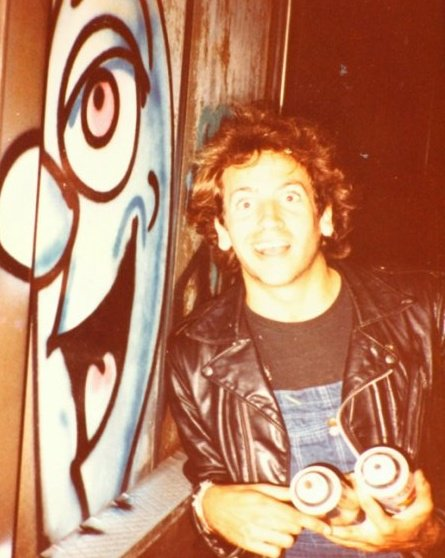 Kenny Scharf in 1982 with the work on the street that got him arrested. (courtesy the artist)