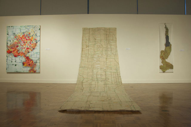 """Installation view, """"Contemporary Cartographies,"""" with Sage Dawson's """"Timeline"""" in the center"""