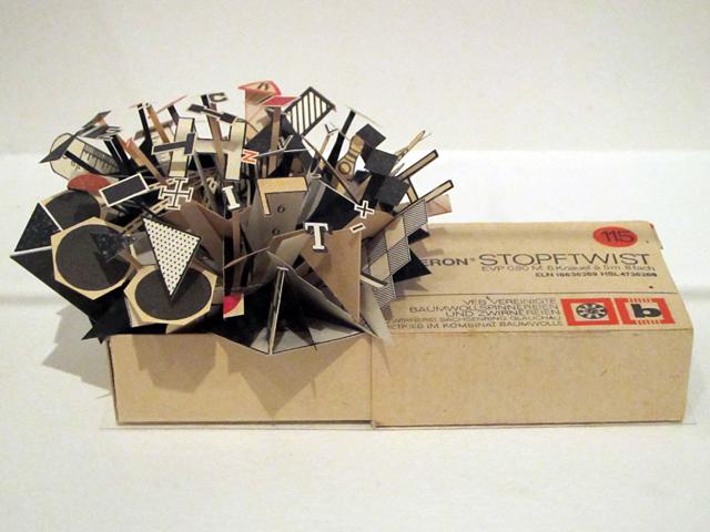 "Sarah Bridgland, ""Stopftwist Cotton Box (black, white and red)"" (2010), paper, enamel paint, found cotton box, glue"