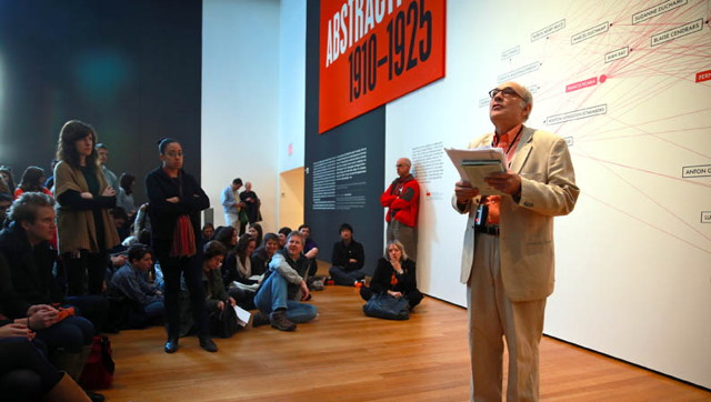 """Charles Bernstein reading in front of the """"Inventing Abstraction"""" exhibition"""