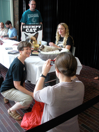 People getting their books signed and taking photos with Grumpy Cat (click to enlarge)