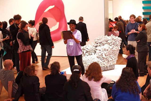 Simone White doing a guerrilla reading at the Museum of Modern Art (© Lawrence Schwartzwald (used with permission; no reproduction without express permission)
