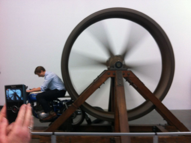"""Chris Burden, """"The Big Wheel"""" (1979). Three-ton, eight-foot diameter, cast-iron flywheel powered by a 1968 Benelli 250cc motorcycle, 112 × 175 × 143 inches. The Museum of Contemporary Art, Los Angeles. Gift of Lannan Foundation."""