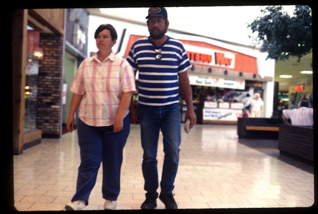 """""""Middle Aged Couple"""" from Michael Galinksy's project """"Malls Across America"""""""