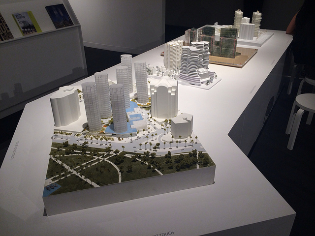 """Maquettes for four proposed condo complex designs in Miami for the """"Four (4): New Visions"""" exhibition at Design Miami. OMA's model in the foreground is the winning design."""