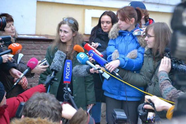 Maria Alekhina speaking with reporters upon her release (via the Committee Against Torture on Facebook)