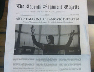 The program-cum-newspaper that announces Abramović's death (photo by the author for Hyperallergic) (click to enlarge)