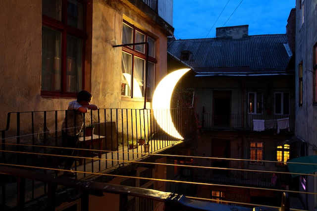"""A boy and the """"Private Moon"""" in Lviv, Ukraine, 2012"""