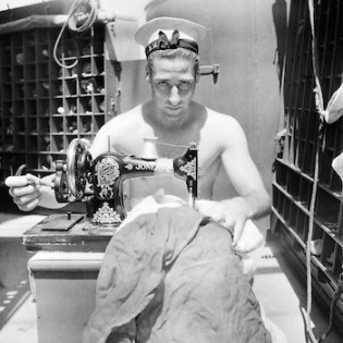 Photograph by Cecil Beaton of a sailor on the HMS Alcantara in 1942 (courtesy Imperial War Museums)