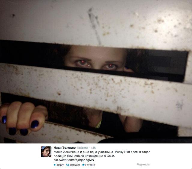 A photo tweeted by Nadezhda Tolokonnikova shows Maria Alekhina in a police van in Sochi. (photo by Nadezhda Tolokonnikova, via Twitter)