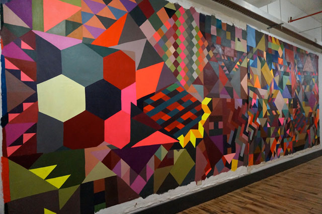 A mural by curator Christine Finley hanging in the hallway