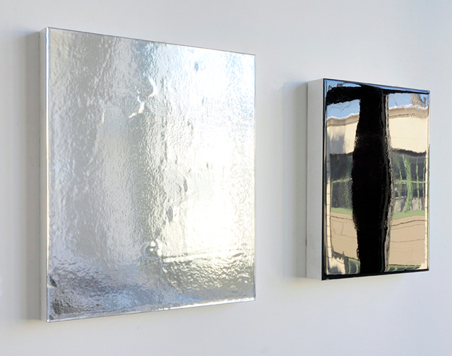 recto/verso,  (angle view), diptych, reflective vinyl film and mixed media on wood panel,  left panel: 16 inches x 14 inches, right panel: 13.75 inches x 10.75 inches (installed 5 inches apart),  2013