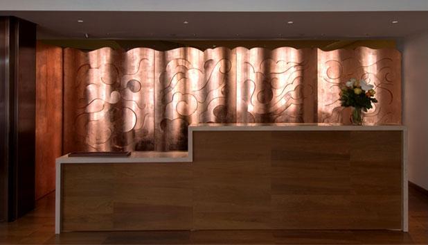 Glaser's copper cloud wall inside the Rubin Museum of Art (via miltonglaser.com)