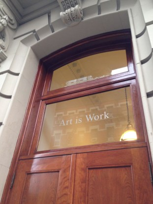 The door to Glaser's building, bearing his motto (photo by the author for Hyperallergic) (click to enlarge)