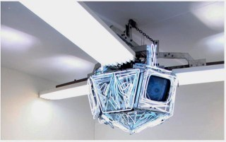 Nam June Paik, Diamond Sat, 1998, 3 TVs, 1 channel, neon bulbs, courtesy Galerie Hans Mayer