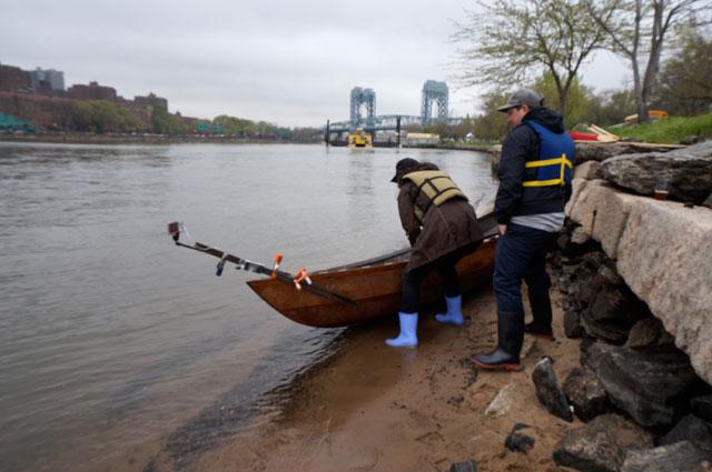Lorenz and artist Daniel Rich launching the boat