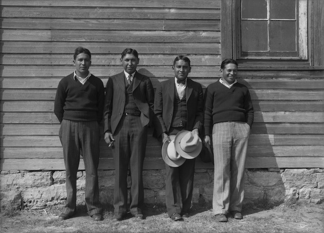 Caption: The deacons of Rainy Mountain Baptist Church. Left to right: Adolphus Goombi (Kiowa), Lester Momaday (Kiowa), Robert Goombi (Kiowa), Porter Drywater (Cherokee). Rainy Mountain Church, Mountain View, Oklahoma, ca. 1930. 57PN12