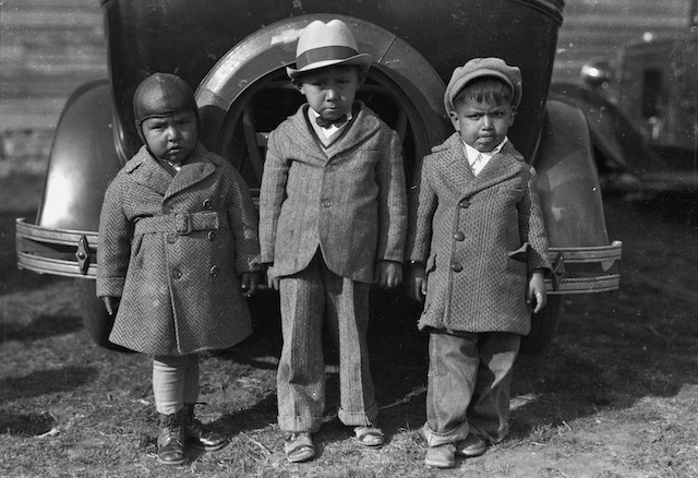"Caption: Left to right: Newton Poolaw (Kiowa), Jerry Poolaw (Kiowa), Elmer Thomas ""Buddy"" Saunkeah (Kiowa). Mountain View, Oklahoma, ca. 1928. 57FK1"