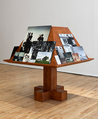 """Jill Magid, """"Der Trog"""" (2013), from her installation Facistol (pine lectern inspired by Luis Barragán, mounted reproductions from Luis Barragán's personal archive), architectural model, as it was exhibited at Art in General during Performa 13. (photo by Steven Probert, via artingeneral.org)"""