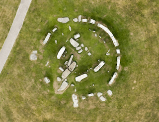 An aerial photograph of Stonehenge by Damian Grady. The images were commissioned following grass discoloration caused by a faulty hose pipe. A new report suggests that the monument may have once been a perfect circle (courtesy English Heritage)