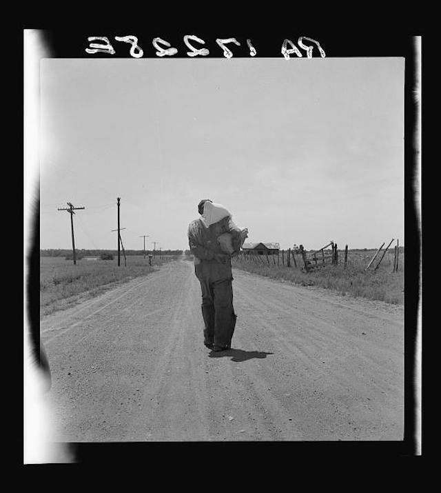 Man walking home with relief provisions near Oil City, Oklahoma, photograph by Dorothea Lange (June 1937) (via Photogrammar/Libray of Congress)