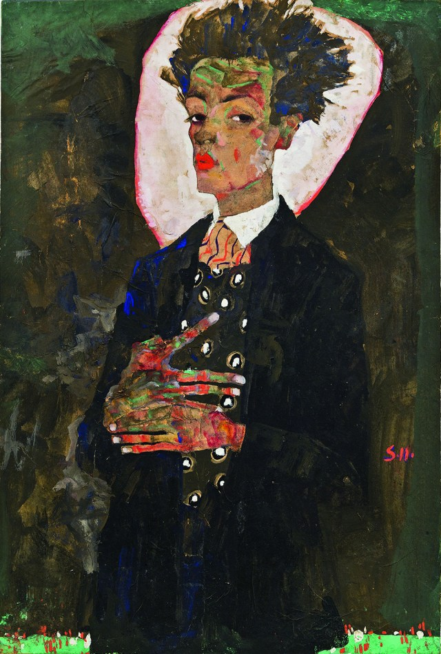 """Egon Schiele, """"Self-Portrait with Peacock Waistcoat, Standing"""" (1911), gouache, watercolor, and black crayon on paper, mounted on board (collection of Ernst Ploil, Vienna, all images courtesy the Neue Galerie, New York)"""