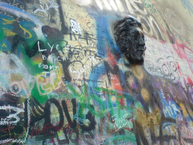 A bas relief portrait on the John Lennon Wall in 2007 (photo by brandon schauer/Flickr)