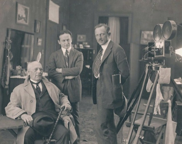On the set of 'The Grim Game' (1919). L to R: magician Harry Kellar, Harry Houdini, & director Irvin Willat (Paramount/Arthur Moses Collection, via Wikimedia)