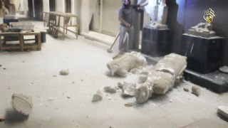 A destroyed statue in the Mosul Museum