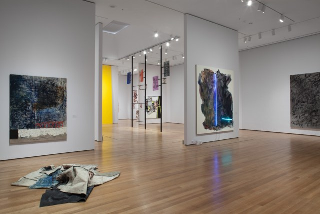 Installation view of 'The Forever Now: Contemporary Painting in an Atemporal World' at The Museum of Modern Art, New York, with Oscar Murillo's unstretched paintings at left (photo by John Wronn; © 2014 The Museum of Modern Art)