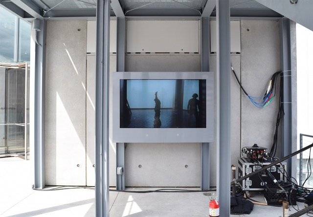 Video of an Yvonne Rainer performance at the Whitney Museum in 1970 plays on one of the terraces