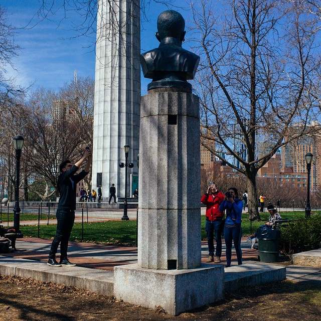 Park-goers photographing the bust of Edward Snowden in Fort Greene Park (photo by Jon Pack/Flickr)