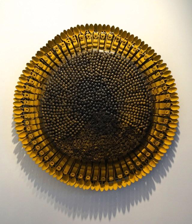 "Olu Amoda, ""Medium Sunflower iii"" (2014), blind revert, steel belt, mild still pipe, 52 x 52 in, at the booth of Art Twenty One"