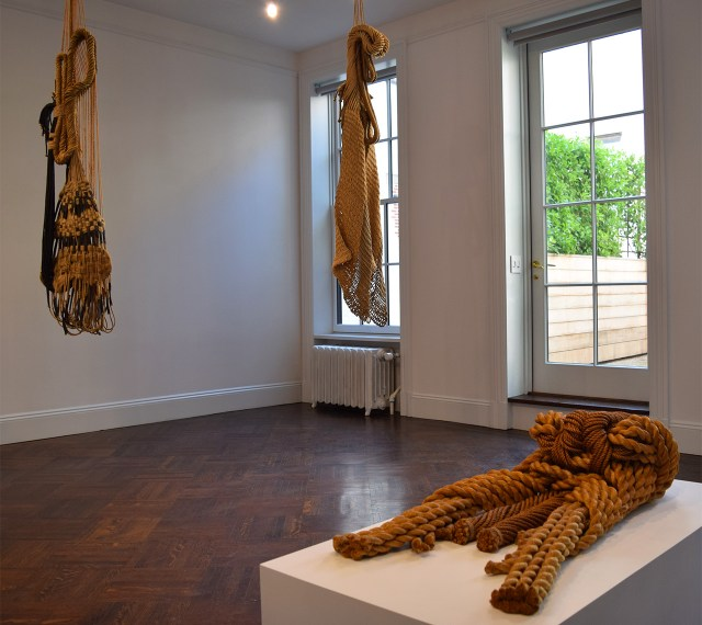 """Installation view with Françoise Grossen's """"Euphrosyne"""" (1991, left), """"Thalia (all natural)"""" (1991, center), and """"Sisyphe"""" (1974, right)"""