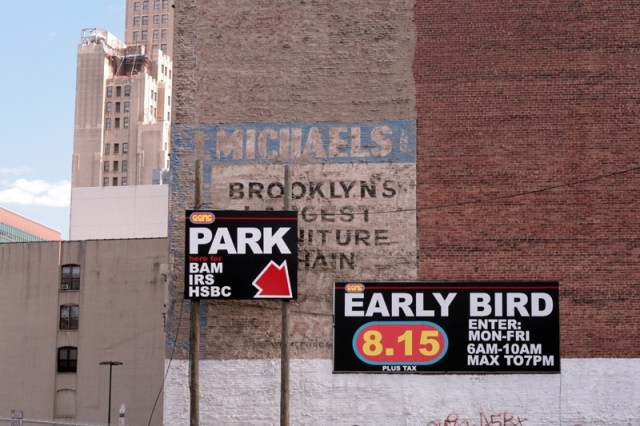 A ghost sign and new parking signs in New York City