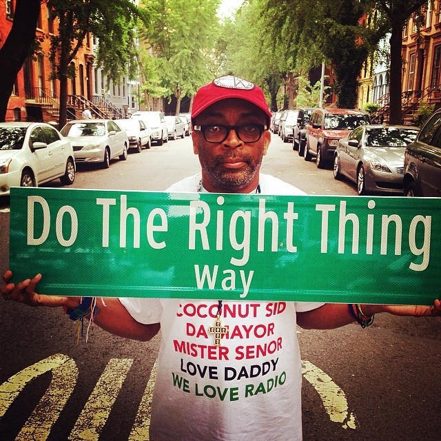 """Spike Lee with a mockup of the """"Do the Right Thing Way"""" street sign (photo by @sheltonjlee/Twitter)"""