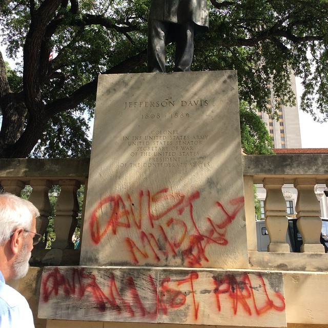 The vandalized statue of Jefferson Davis at the University of Texas at Austin (photo by @tinyjune/Instagram)
