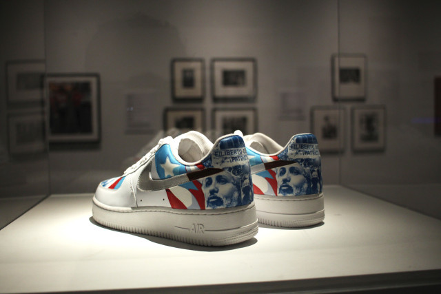 """Miguel Luciano, """"Machetero Air Force One's (Filiberto Ojeda Uptowns"""" (2007) vinyl and acrylic on sneakers, 11 x 4 x 4 ½ inches"""