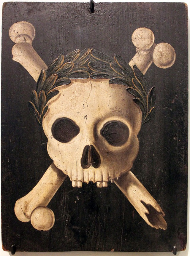 Plague panel showing death crowned with triumphant laurels. These types of panels were placed on German houses to warn against the plague in the 17th century (via Deutsches Historisches Museum Berlin)