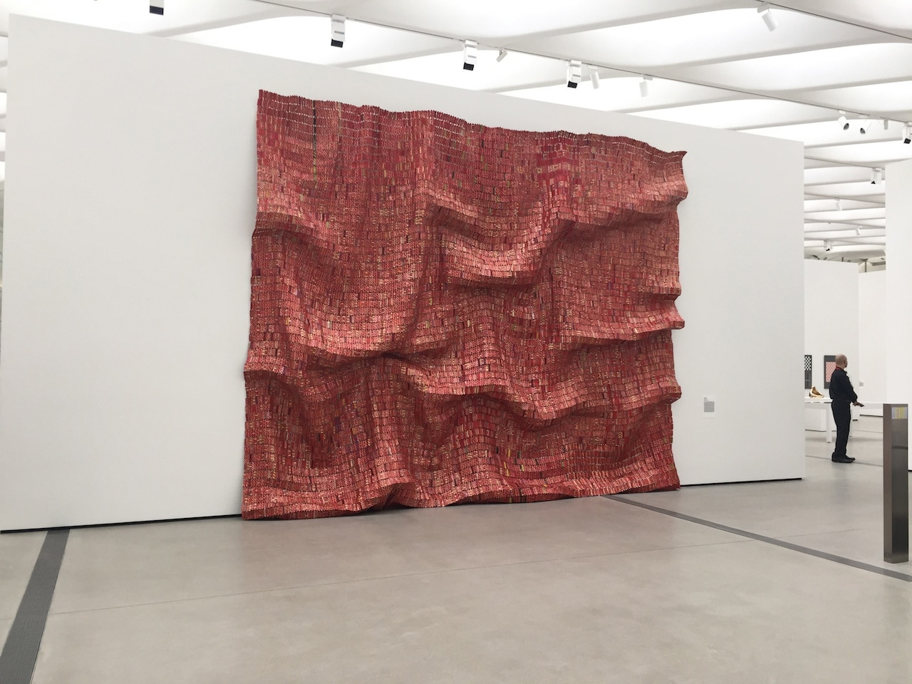 "El Anatsui, ""Red Block"" (2010), found aluminum and copper wire, 200 3/4 x 131 1/2 in."